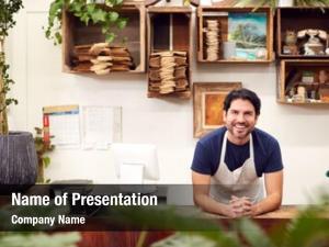 Male portrait smiling sales assistant