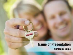 Holding happy couple house key