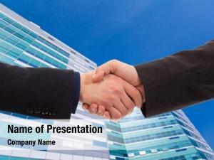 Businessmen handshake between