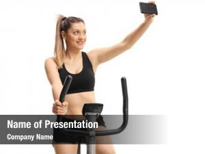 Cross trainer young woman exercising
