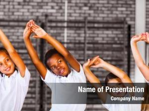 Exercise teacher teaching school kids