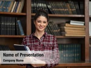 Student happy university holding books