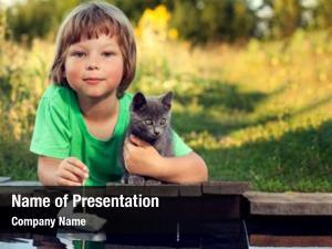 Beloved boy his kitten playing