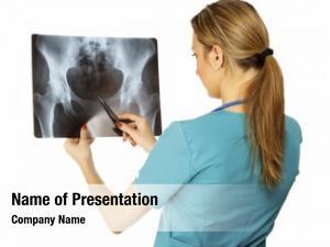 Examining female doctor x ray