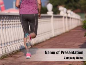 Jogging sporty woman sidewalk early