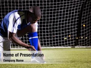 Player male soccer tying shoelace